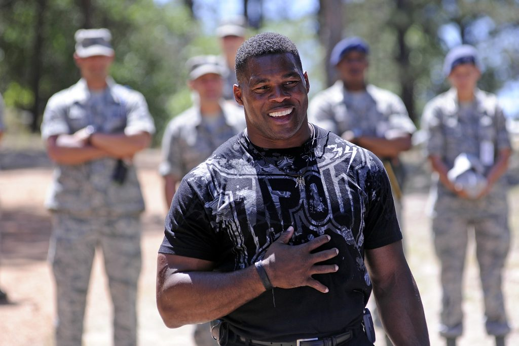 Football great Herschel Walker speaks to the Class of 2016 during Basic Cadet Training in the U.S. Air Force Academy's Jacks Valley in Colorado Springs, Colo. July 17, 2012. Walker spent time talking to the Class of 2016 about resiliency, his own personal struggles in life and encouraged the cadets to reach out and seek help if they need it.